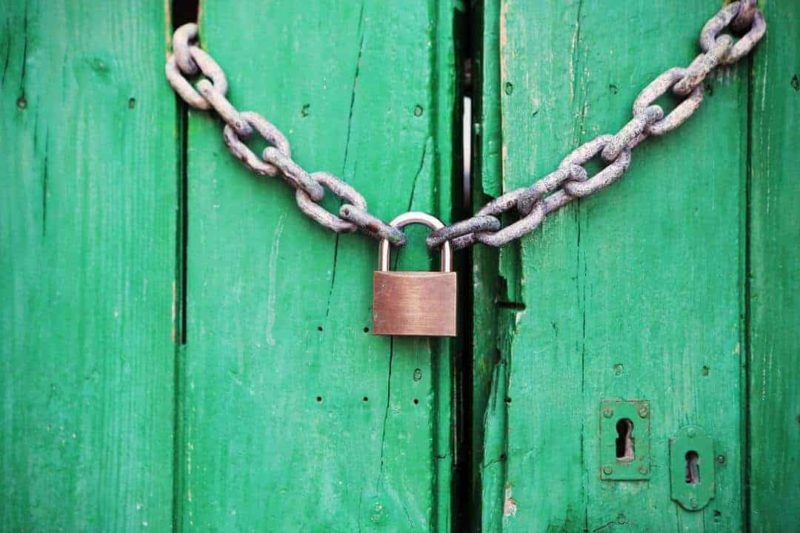 green door with chain and lock