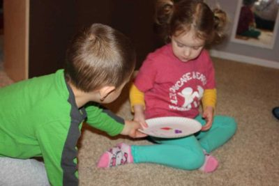 two preschoolers playing table manners game