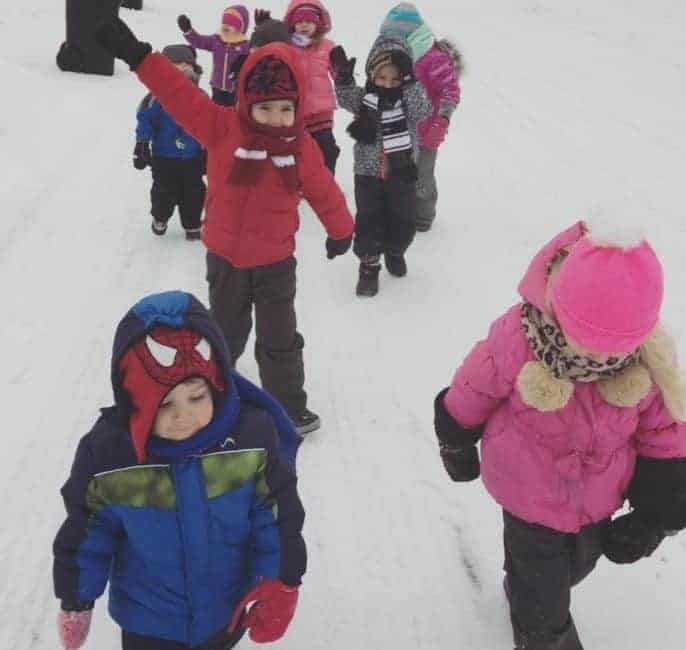 family child care group walking in winter gear