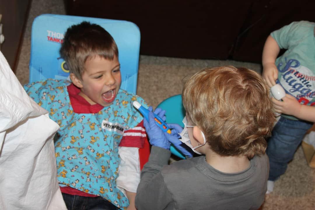 boys playing dentist dramatic play