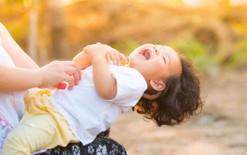 toddler giggling after conflict resolution