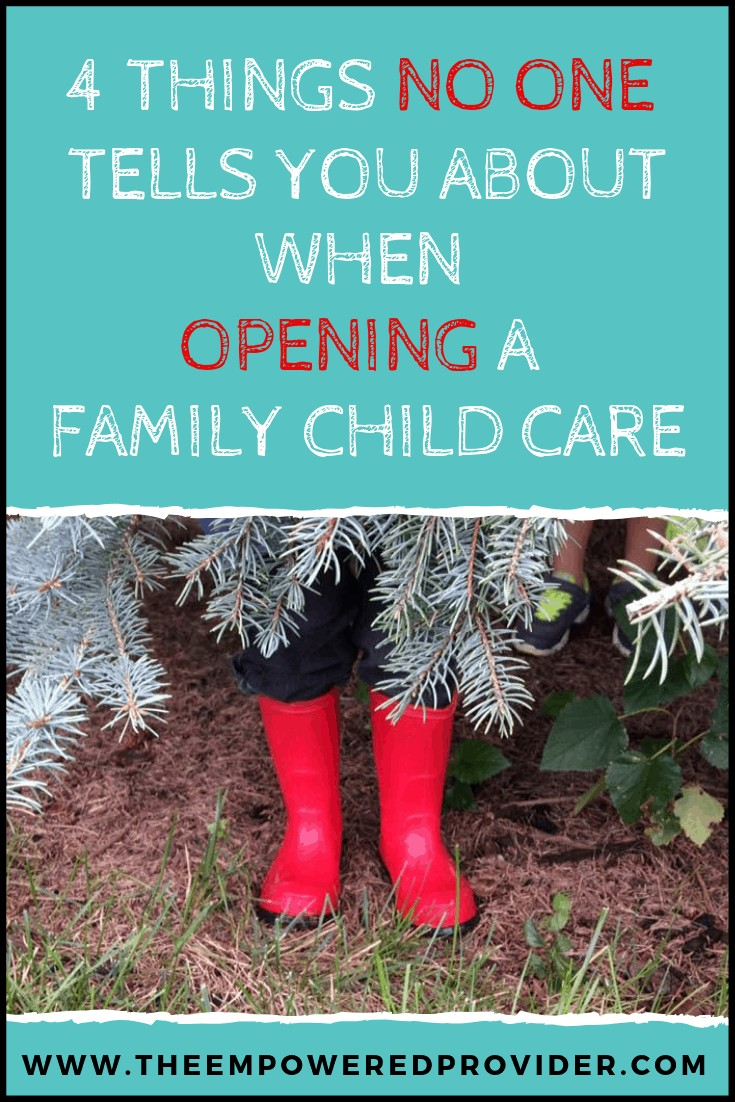 red boots peeking out of evergreen tree