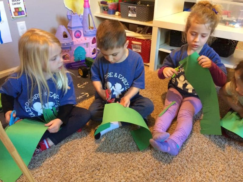 young kids making a preschool Earth Day craft