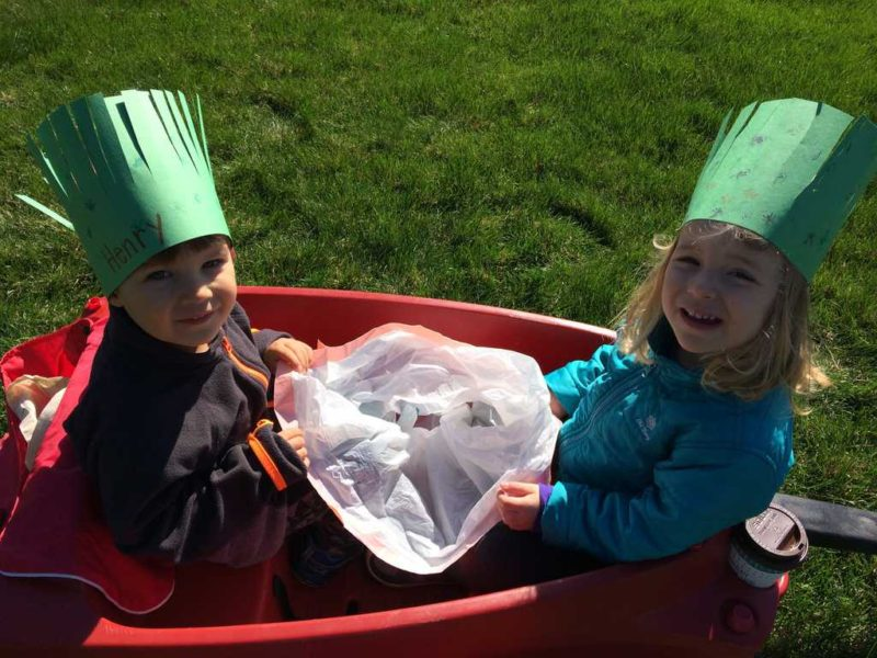 young boy and young girl in wagon  on earth day