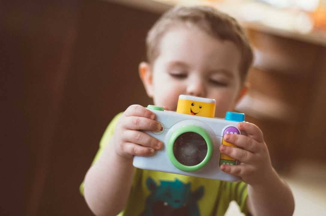 toddler sharing toy camera