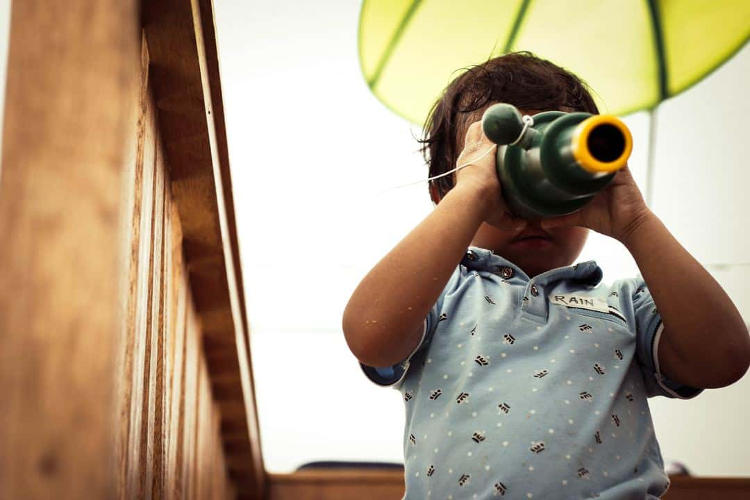 Young boy looking through telescope