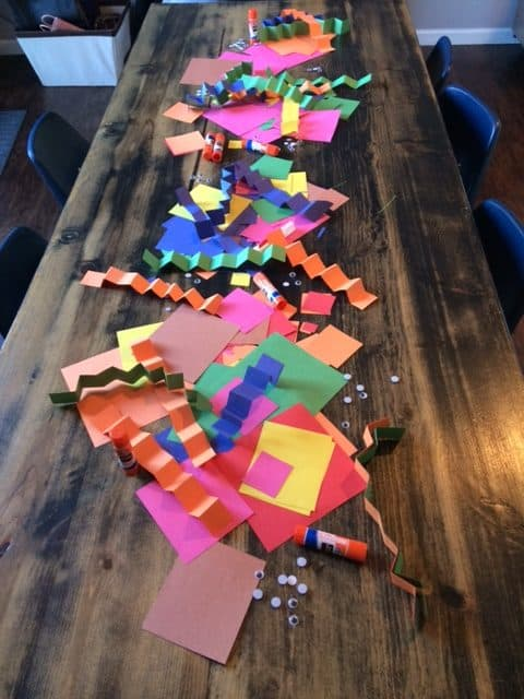 pile of pre cut colorful paper on table for a gluing activity for preschoolers