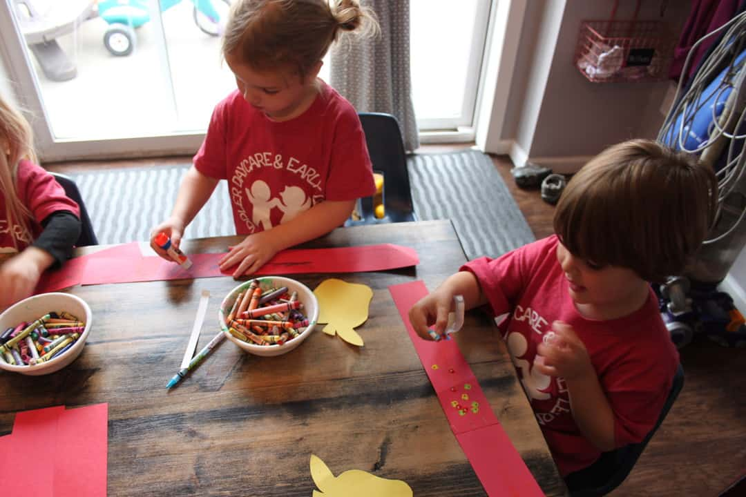 preschool group making paper apple headbands