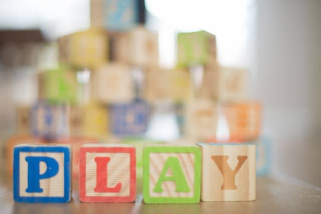 wooden toy blocks that spell out the word play