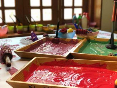 finger painting trays in a classroom