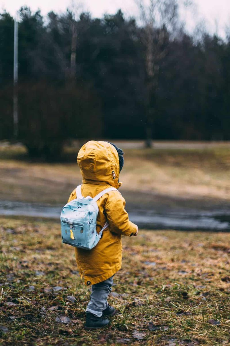 boy walking outside heading to a daycare interview