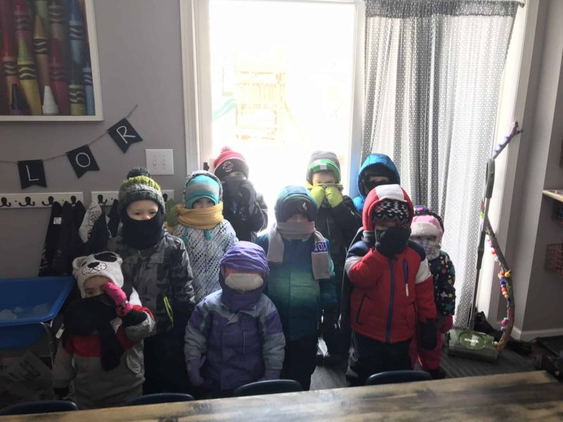 group of family child care kids dressed for winter